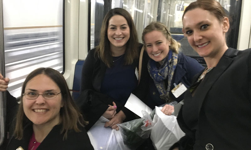 The UCI Reproductive Justice Law Clinic (RJC) takes a class field trip to Washington D.C. — pictured here on the Senate Subway traveling to meet one of Senator Diane Feinstein's staff members.   <sub>(Front L to R) Jaime Allgood (Public Health Doctoral Candidate), Hayley Penan (3L at UCI's School of Law) and (Back L to R) Ali Chabot (2L at UCI's School of Law), Andie Diaz (3L at UCI's School of Law).</sub>