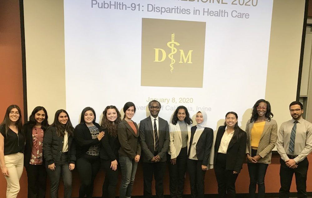 """The 2020 cohort of """"Diversity in Medicine"""" student coordinators work to improve interdisciplinary understanding toward reforming """"Disparities in Healthcare"""". <p style=line-height:10px><small><sup>The interdisciplinary program is directed by Dr. Dele Ogunseitan (Program in Public Health), Dr. Charles Vega (School of Medicine/PRIME-LC), Dr. Candace Burton (Sue & Bill Gross School of Nursing) and Dr. Terrance Mayes (Associate Vice Chancellor, Susan & Henry Samueli College of Health Sciences)."""" Students from more than 20 Majors across all UCI Schools are enrolled in Winter 2020</sup></small></p>"""